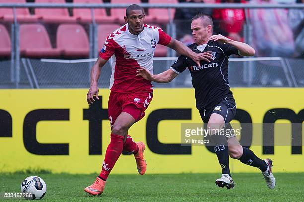 Sebastien Haller of FC Utrecht Ramon Zomer of Heracles Almelo during the Europa League Playoffs return match between FC Utrecht and Heracles Almelo...