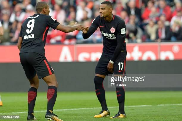 Sebastien Haller of Frankfurt and KevinPrince Boateng of Frankfurt celebrate a goal during the Bundesliga match between 1 FC Koeln and Eintracht...