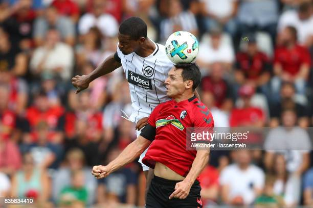 Sebastien Haller of Frankfurt and Nicolas Hoefler of FC Freiburg during the Bundesliga match between SportClub Freiburg and Eintracht Frankfurt at...