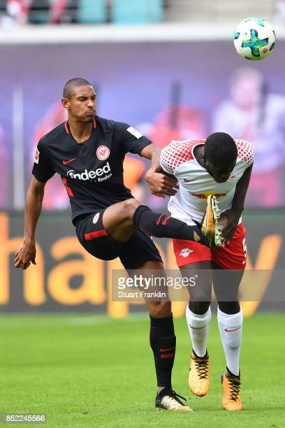 Sebastien Haller of Frankfurt fights for the ball with Dayot Upamecano of Leipzig during the Bundesliga match between RB Leipzig and Eintracht...
