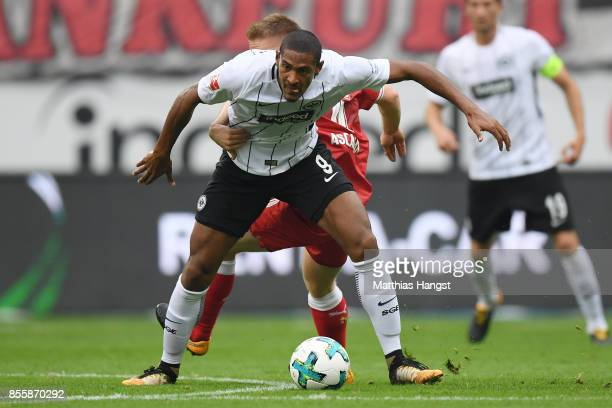 Sebastien Haller of Frankfurt fights for the ball with Santiago Ascacibar of Stuttgart during the Bundesliga match between Eintracht Frankfurt and...