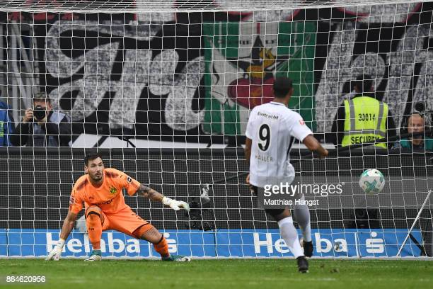 Sebastien Haller of Frankfurt scores a goal from the penalty spot past Roman Buerki of Dortmund to make it 12 during the Bundesliga match between...