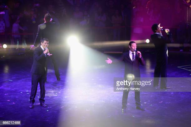 Sebastien Izambard David Miller Urs Buhler and Carlos Marin of Il Divo perform during the Grand Opening of The Mall of Qatar at Mall of Qatar on...