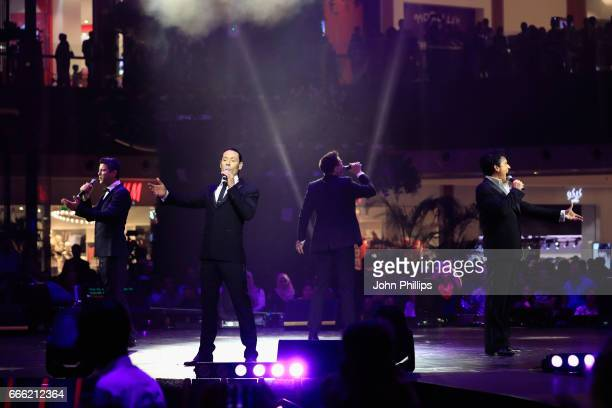 Sebastien Izambard Urs Buhler David Miller and Carlos Marin of Il Divo perform during the Grand Opening of The Mall of Qatar at Mall of Qatar on...