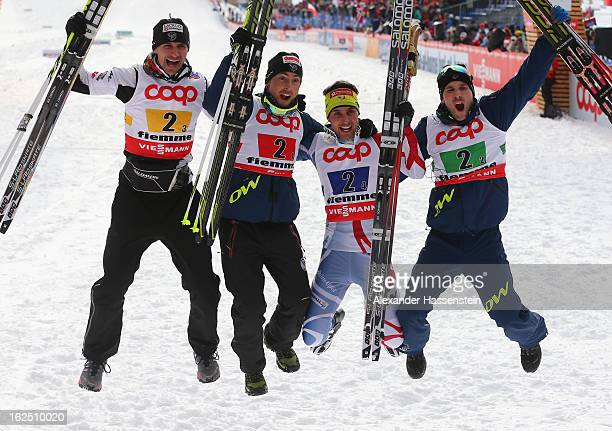 Sebastien Lacroix Francois Braud Jason Lamy Chappuis and Maxime Laheurte of France celebrate victory in the Nordic Combined Team 4x5km at the FIS...