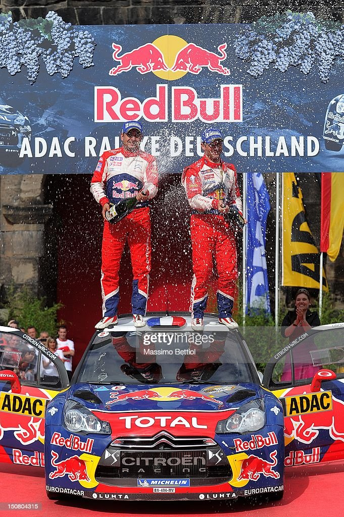 Sebastien Loeb of France and <a gi-track='captionPersonalityLinkClicked' href=/galleries/search?phrase=Daniel+Elena&family=editorial&specificpeople=212897 ng-click='$event.stopPropagation()'>Daniel Elena</a> of Monaco celebrate their victory during Day 3 of the WRC Rally Germany on August 26, 2012 in Trier, Germany.