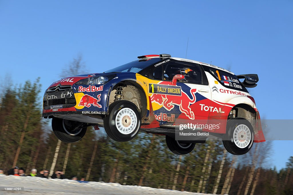 Sebastien Loeb of France and Daniel Elena of Monaco compete in their Citroen Total WRT Citroen DS3 WRC during Day 3 of the WRC Rally Sweden on...