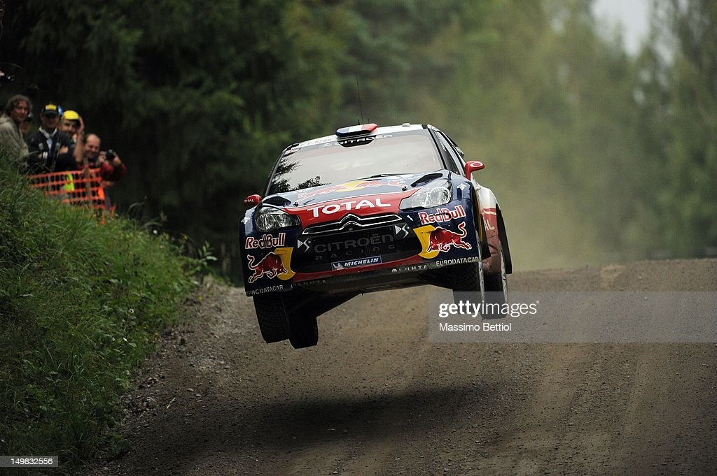 Sebastien Loeb of France and <a gi-track='captionPersonalityLinkClicked' href=/galleries/search?phrase=Daniel+Elena&family=editorial&specificpeople=212897 ng-click='$event.stopPropagation()'>Daniel Elena</a> of Monaco compete in their Citroen Total WRT Citroen DS3 WRC during Day 3 of the WRC Rally Finland on August 04, 2012 in Jyvaskyla , Finland.