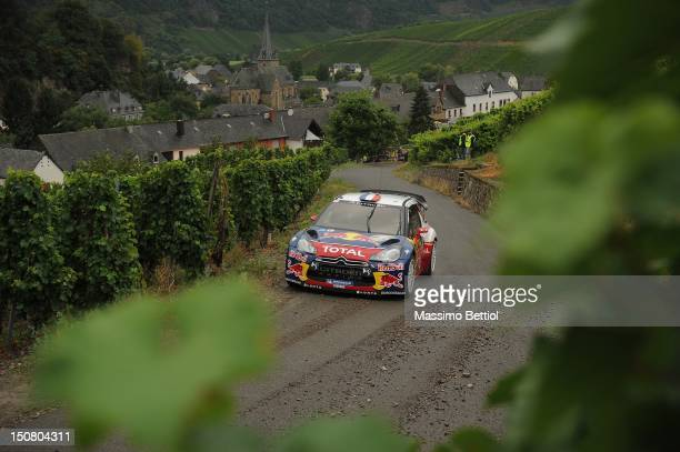 Sebastien Loeb of France and Daniel Elena of Monaco compete in their Citroen Total WRT Citroen DS3 WRC during Day 3 of the WRC Rally Germany on...