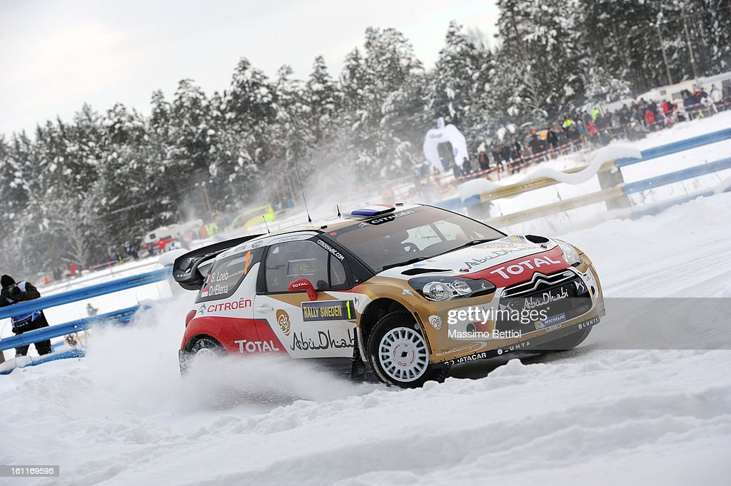 <a gi-track='captionPersonalityLinkClicked' href=/galleries/search?phrase=Sebastien+Loeb&family=editorial&specificpeople=203172 ng-click='$event.stopPropagation()'>Sebastien Loeb</a> of France and <a gi-track='captionPersonalityLinkClicked' href=/galleries/search?phrase=Daniel+Elena&family=editorial&specificpeople=212897 ng-click='$event.stopPropagation()'>Daniel Elena</a> of Monaco compete in their Citroen Total Abu Dhabi WRT Citroen DS3 WRC during Day Two of the WRC Sweden on February 09 , 2013 in Karlstad , Sweden.