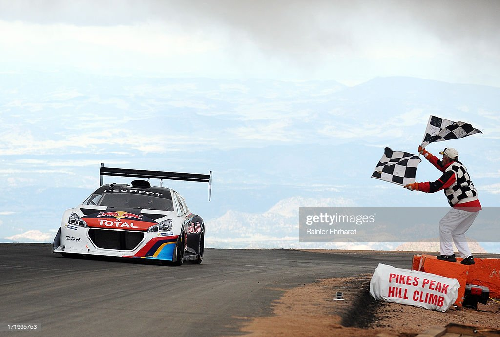 Sebastien Loeb, of France, driver of the #208 Peugeot 208 T16 Pikes Peak, crosses the finish line setting a record time of 8:13.878 during the Pikes Peak International Hill Climb on June 30, 2013 in Colorado Springs, Colorado.