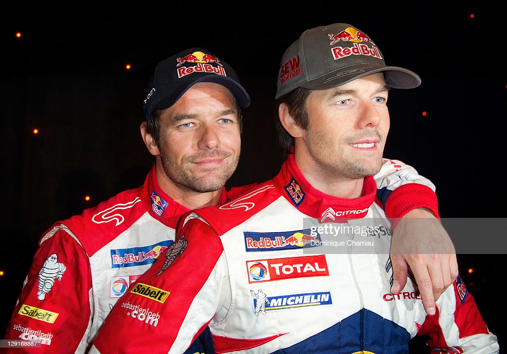 Sebastien Loeb (L) poses next to his wax figure at Musee Grevin on October 13, 2011 in Paris, France..