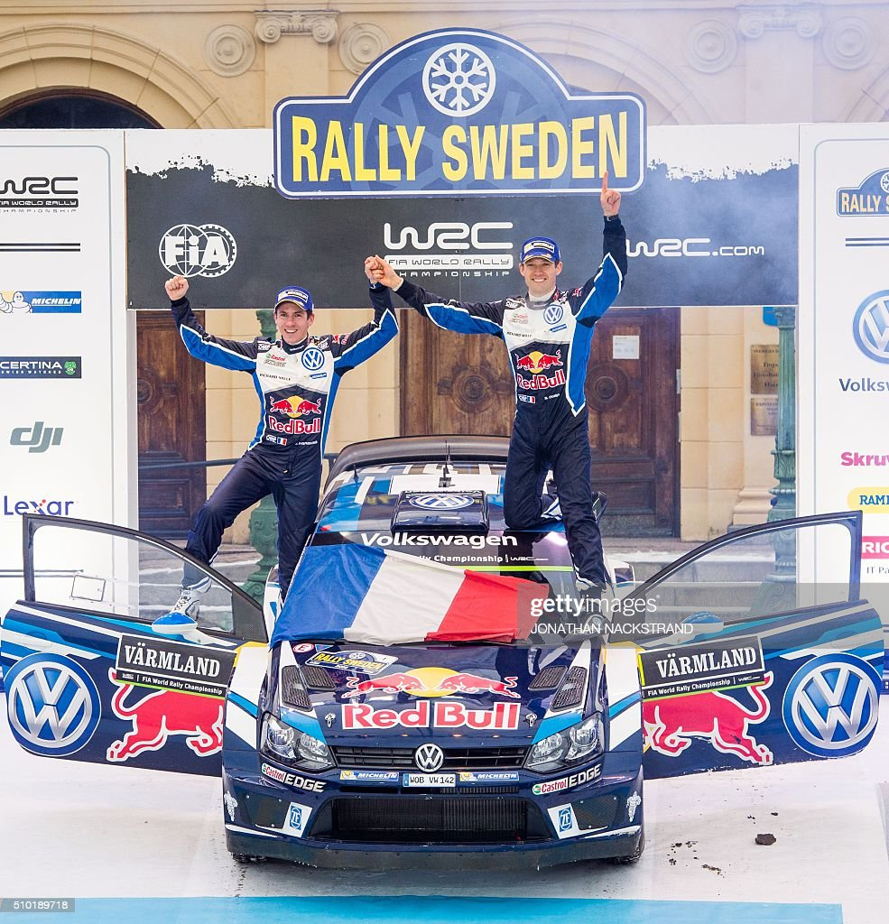 Sebastien Ogier (R) of France and his co-driver Julien Ingrassia celebrate on their Volkswagen Polo during the winner's ceremony of Rally Sweden, second round of the FIA World Rally Championship on February 14, 2016 in Karlstad, Sweden. / AFP / JONATHAN NACKSTRAND