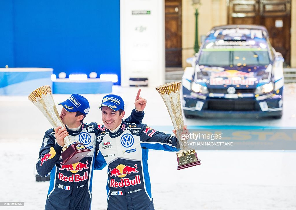 Sebastien Ogier (L) of France and his co-driver Julien Ingrassia celebrate on their Volkswagen Polo during the winner's ceremony of Rally Sweden, second round of the FIA World Rally Championship on February 14, 2016 in Karlstad, Sweden. / AFP / JONATHAN NACKSTRAND