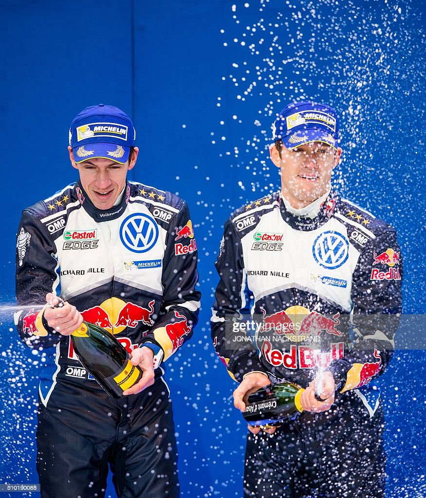 Sebastien Ogier (R) of France and his co-driver Julien Ingrassia celebrate during the winner's ceremony of Rally Sweden, second round of the FIA World Rally Championship on February 14, 2016 in Karlstad, Sweden. / AFP / JONATHAN NACKSTRAND