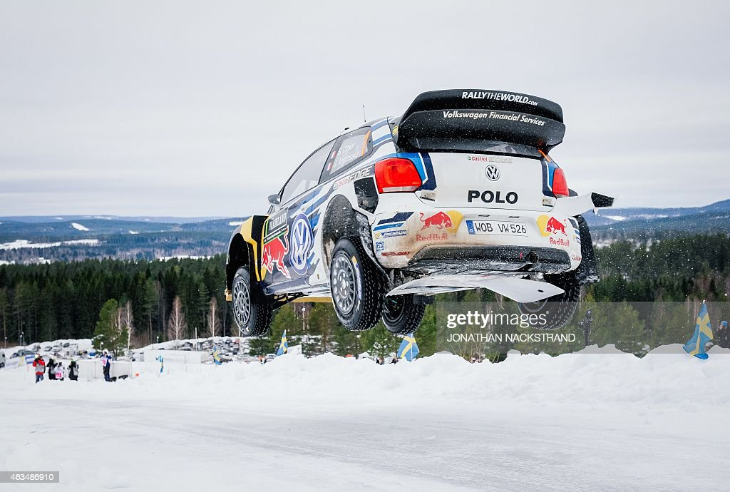 Sebastien Ogier of France and his codriver Julien Ingrassia of France steer their Volkswagen Polo R WRC during the 20th stage of the Rally Sweden...