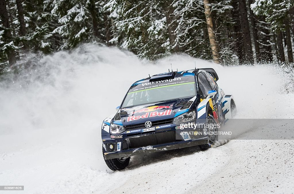 Sebastien Ogier of France and his codriver Julien Ingrassia steer their Volkswagen Polo during the 14th stage of the Rally Sweden second round of the...