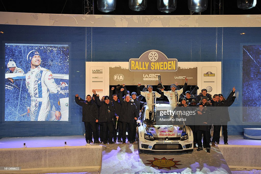 Sebastien Ogier of France and Julien Ingrassia of France celebrate their victory with all the Volkswagen Motorsport WRT members during Day Three of the WRC Sweden on February 10 , 2013 in Karlstad , Sweden.