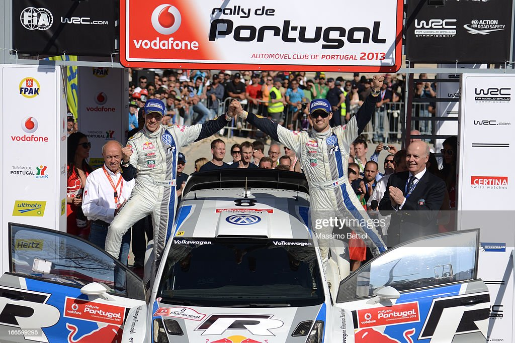 <a gi-track='captionPersonalityLinkClicked' href=/galleries/search?phrase=Sebastien+Ogier&family=editorial&specificpeople=4946813 ng-click='$event.stopPropagation()'>Sebastien Ogier</a> of France and <a gi-track='captionPersonalityLinkClicked' href=/galleries/search?phrase=Julien+Ingrassia&family=editorial&specificpeople=4947850 ng-click='$event.stopPropagation()'>Julien Ingrassia</a> of France celebrate their victory in the final on the podium in front of the Algarve Stadium, during Day Three of the WRC Portugal on April 14 , 2013 in Faro , Portugal.