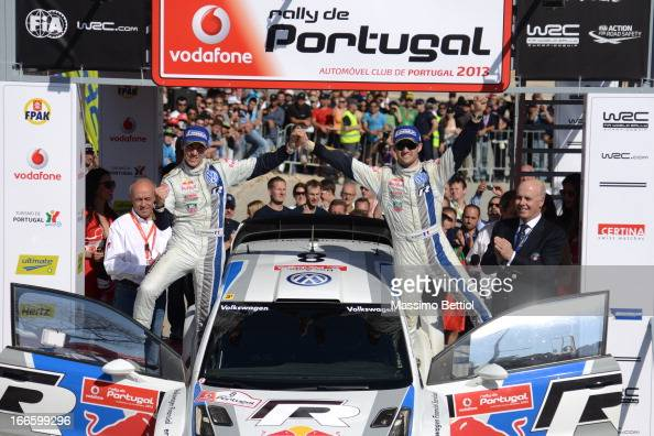 Sebastien Ogier of France and Julien Ingrassia of France celebrate their victory in the final on the podium in front of the Algarve Stadium during...