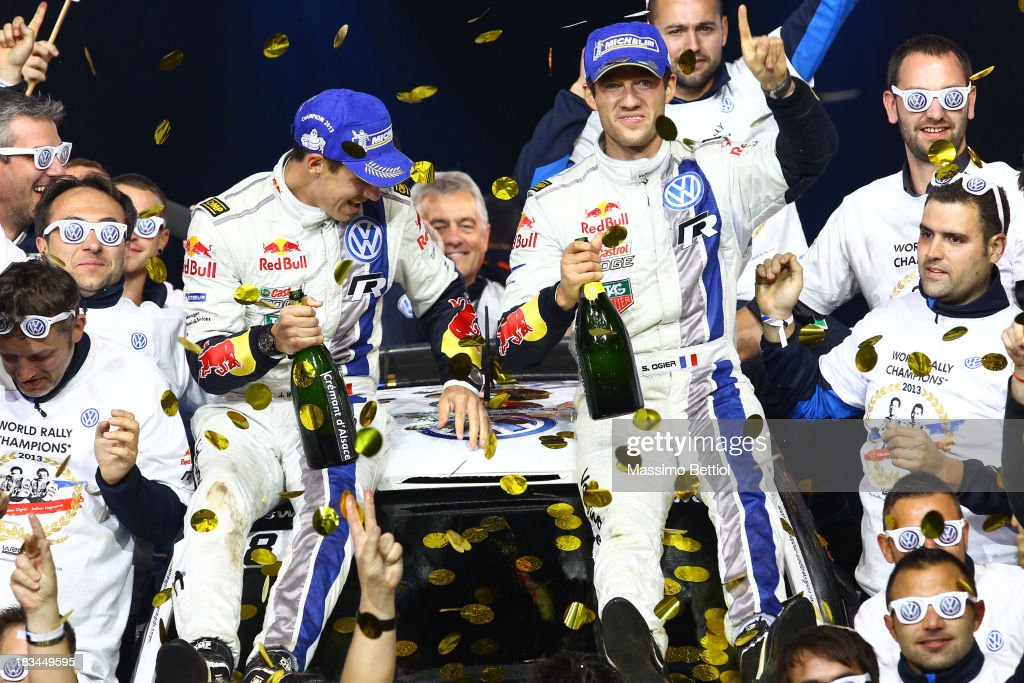 Sebastien Ogier of France and Julien Ingrassia of France celebrate their World Rally Title with all the Volkswagen Motorsport staff members on the final podium in Strasbourg on Day Three of the WRC France on October 6, 2013 in Strasbourg, France.