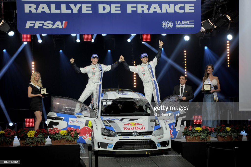 Sebastien Ogier of France and Julien Ingrassia of France celebrate their World Rally Championship Title in the final podium during Day Three of the WRC France on October 6, 2013 in Strasbourg, France.