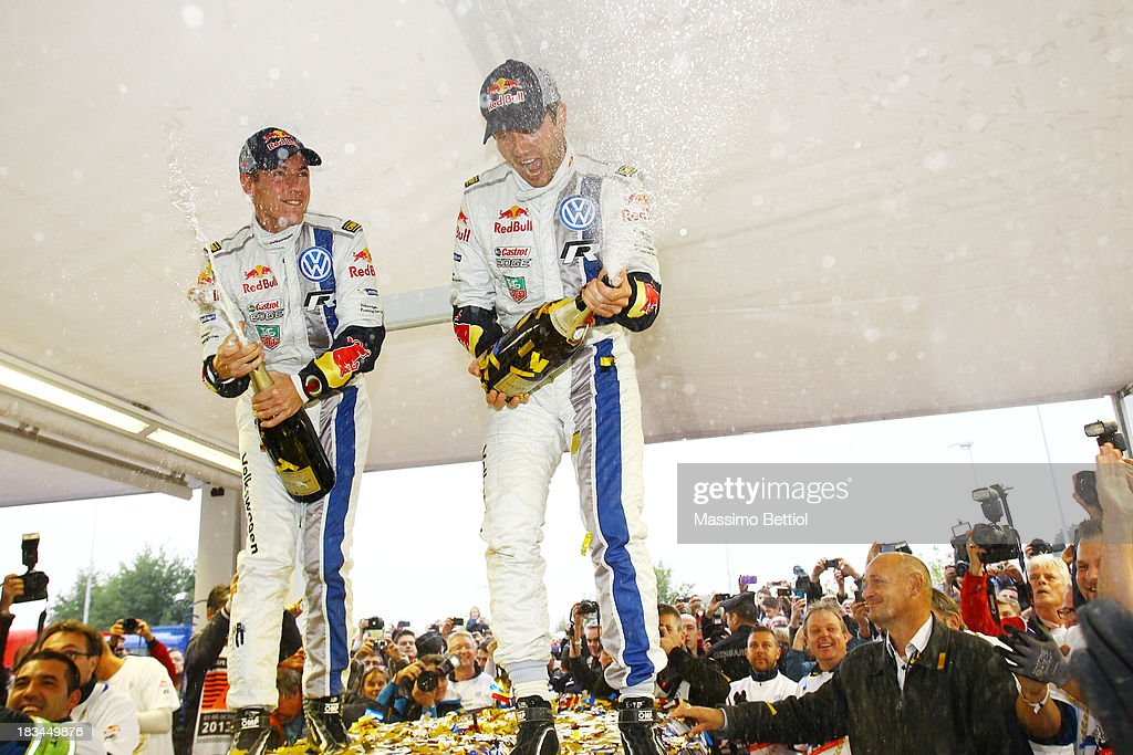 Sebastien Ogier of France and Julien Ingrassia of France celebrate their World Rally Championship Title in the final service park during Day Three of the WRC France on October 6, 2013 in Strasbourg, France.