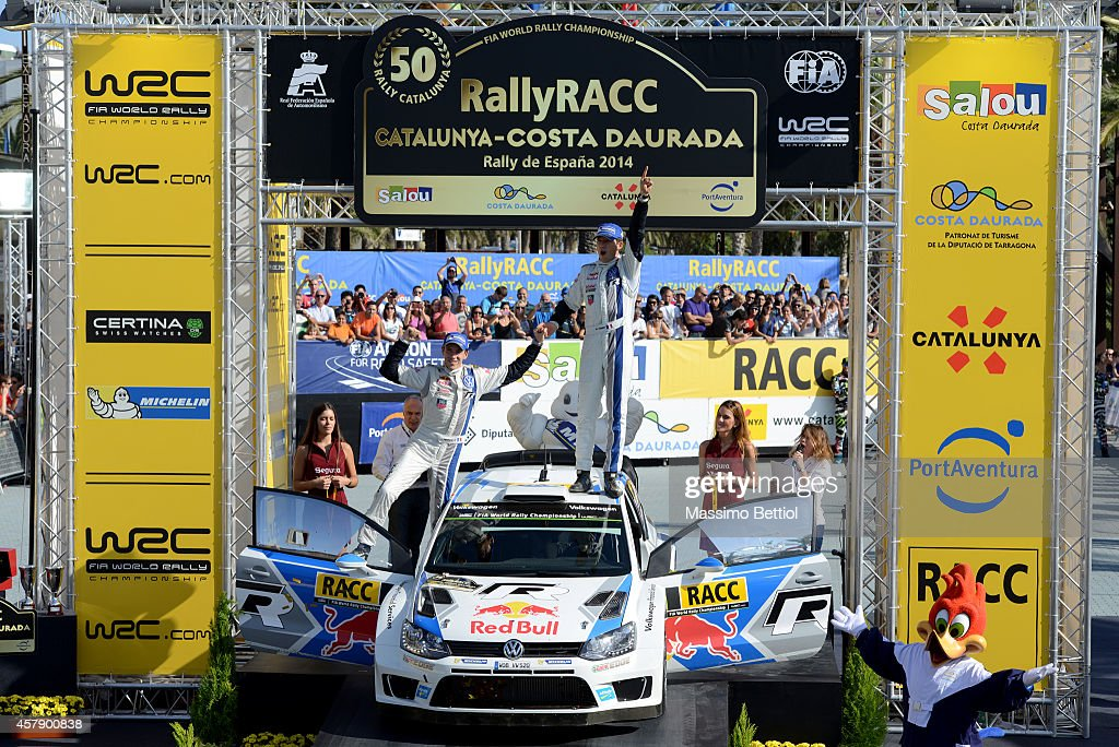<a gi-track='captionPersonalityLinkClicked' href=/galleries/search?phrase=Sebastien+Ogier&family=editorial&specificpeople=4946813 ng-click='$event.stopPropagation()'>Sebastien Ogier</a> of France and <a gi-track='captionPersonalityLinkClicked' href=/galleries/search?phrase=Julien+Ingrassia&family=editorial&specificpeople=4947850 ng-click='$event.stopPropagation()'>Julien Ingrassia</a> of France celebrate their Worl Rally Champion title on the final podium during Day Three of the WRC Spain (3) of the WRC Spain (3) on October 26, 2014 in Salou, Spain.