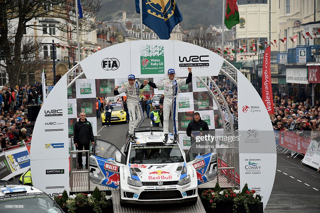 Sebastien Ogier of France and <a gi-track='captionPersonalityLinkClicked' href=/galleries/search?phrase=Julien+Ingrassia&family=editorial&specificpeople=4947850 ng-click='$event.stopPropagation()'>Julien Ingrassia</a> of France celebrate their victory in the final podium during Day Three of the WRC Great Britain on November 16, 2014 in Deeside, United Kingdom.