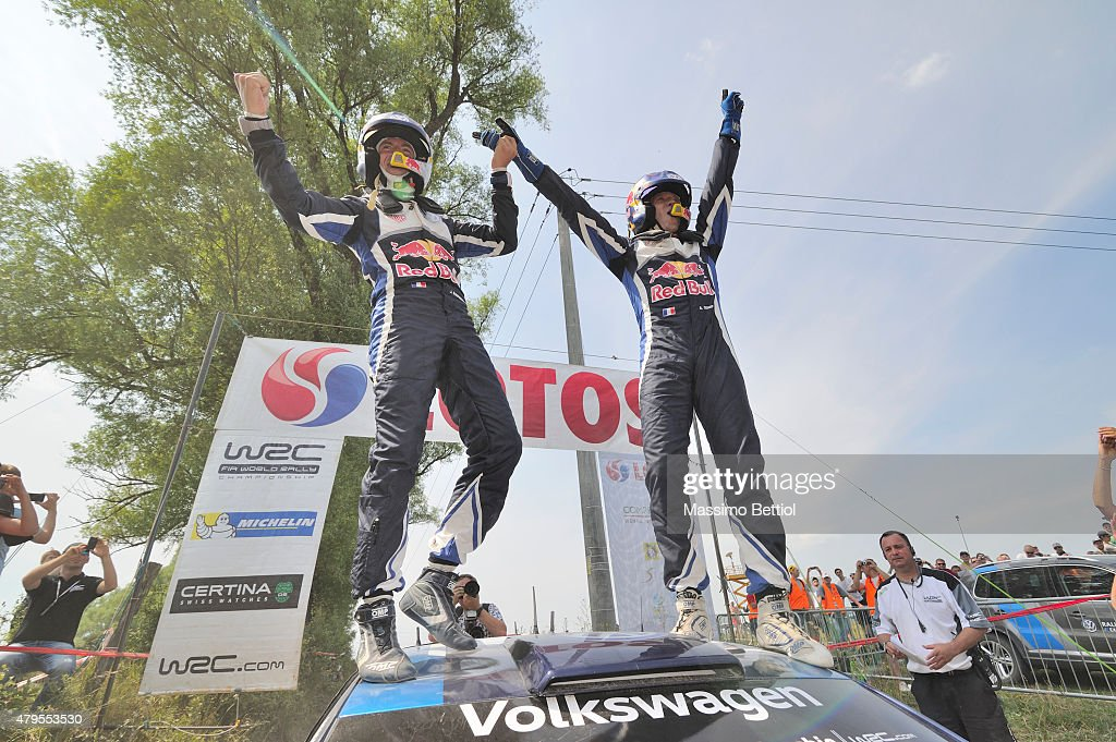 Sebastien Ogier of France and <a gi-track='captionPersonalityLinkClicked' href=/galleries/search?phrase=Julien+Ingrassia&family=editorial&specificpeople=4947850 ng-click='$event.stopPropagation()'>Julien Ingrassia</a> of France celebrate their victory during Day Three of the WRC Poland on July 5, 2015 in Mikolajki, Poland.