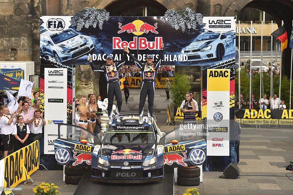 Sebastien Ogier of France and <a gi-track='captionPersonalityLinkClicked' href=/galleries/search?phrase=Julien+Ingrassia&family=editorial&specificpeople=4947850 ng-click='$event.stopPropagation()'>Julien Ingrassia</a> of France celebrate their first position in the final overall during Day Three of the WRC Germany on August 23, 2015 in Trier, Germany.