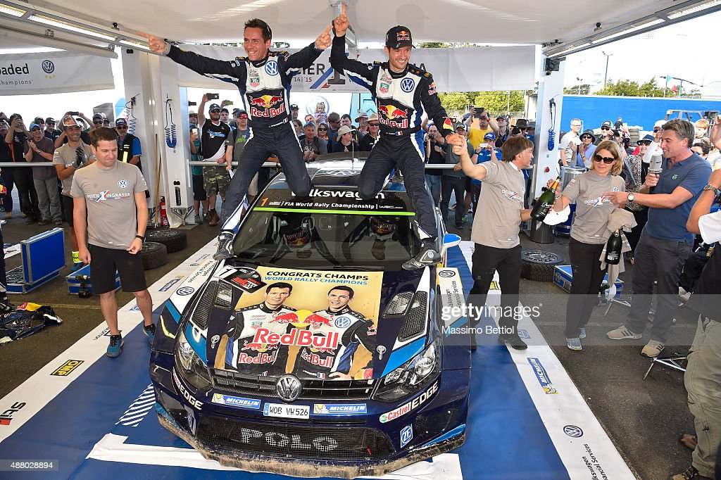 Sebastien Ogier of France and Julien Ingrassia of France celebrate their victory in the rally and their third World Rally Championship Title during Day Three of the WRC Australia on September 13, 2015 in Coffs Harbour, Australia.