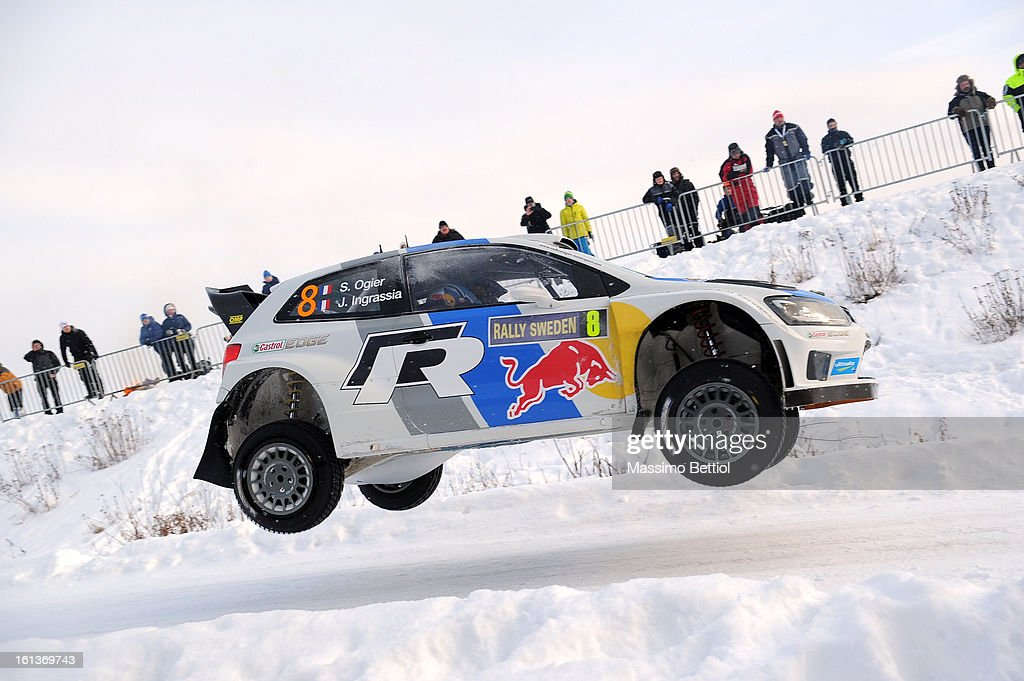 Sebastien Ogier of France and <a gi-track='captionPersonalityLinkClicked' href=/galleries/search?phrase=Julien+Ingrassia&family=editorial&specificpeople=4947850 ng-click='$event.stopPropagation()'>Julien Ingrassia</a> of France compete in their Volkswagen Motorsport Volkswagen Polo R WRC during Day Three of the WRC Sweden on February 10 , 2013 in Karlstad , Sweden.