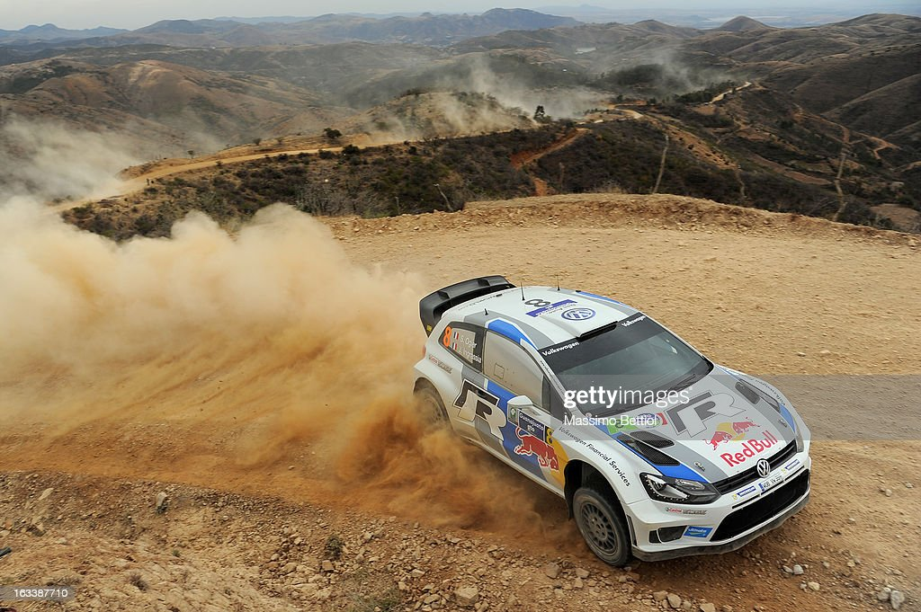 <a gi-track='captionPersonalityLinkClicked' href=/galleries/search?phrase=Sebastien+Ogier&family=editorial&specificpeople=4946813 ng-click='$event.stopPropagation()'>Sebastien Ogier</a> of France and <a gi-track='captionPersonalityLinkClicked' href=/galleries/search?phrase=Julien+Ingrassia&family=editorial&specificpeople=4947850 ng-click='$event.stopPropagation()'>Julien Ingrassia</a> of France compete in their Volkswagen Motorsport Polo R WRC during Day One of the WRC Mexico on March 08 , 2013 in Leon , Mexico.