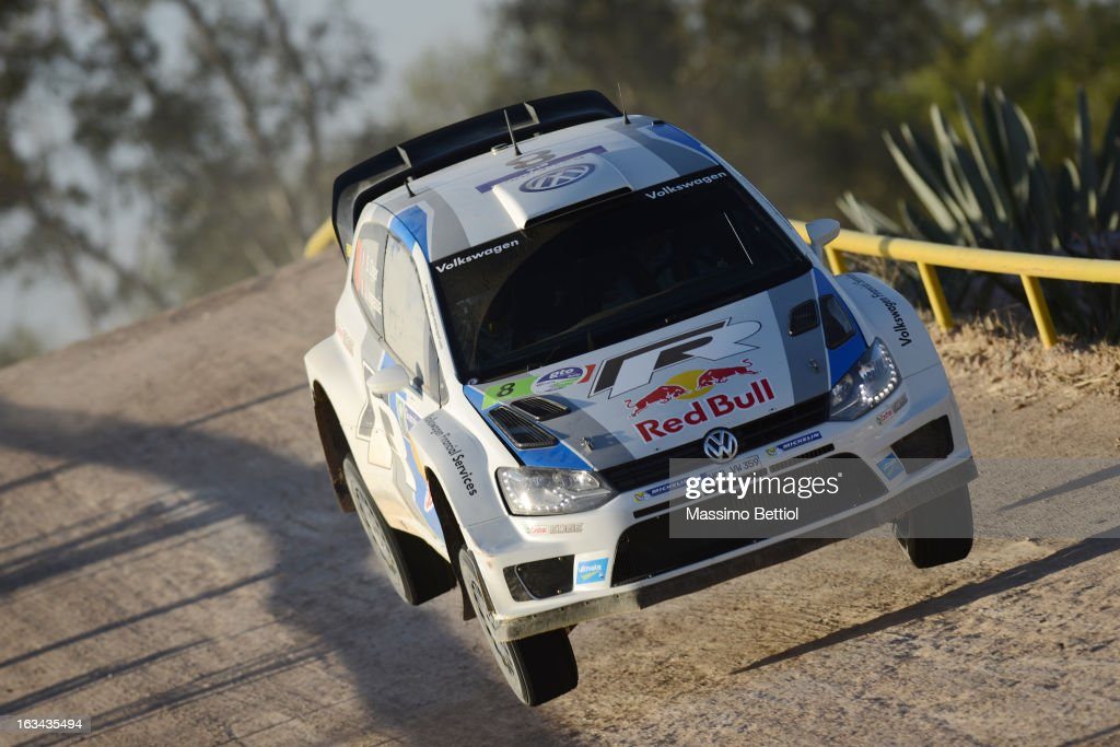 <a gi-track='captionPersonalityLinkClicked' href=/galleries/search?phrase=Sebastien+Ogier&family=editorial&specificpeople=4946813 ng-click='$event.stopPropagation()'>Sebastien Ogier</a> of France and <a gi-track='captionPersonalityLinkClicked' href=/galleries/search?phrase=Julien+Ingrassia&family=editorial&specificpeople=4947850 ng-click='$event.stopPropagation()'>Julien Ingrassia</a> of France compete in their Volkswagen Motorsport Polo R WRC during Day Two of the WRC Mexico on March 09, 2013 in Leon, Mexico.