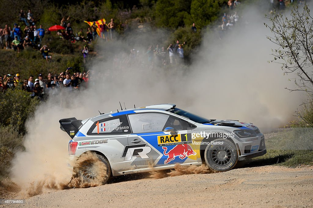 Sebastien Ogier of France and <a gi-track='captionPersonalityLinkClicked' href=/galleries/search?phrase=Julien+Ingrassia&family=editorial&specificpeople=4947850 ng-click='$event.stopPropagation()'>Julien Ingrassia</a> of France compete in their Volkswagen Motorsport Volkswagen Polo R WRC during Day One of the WRC Spain on October 24, 2014 in Salou, Spain.