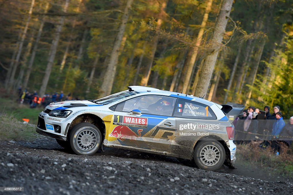 Sebastien Ogier of France and <a gi-track='captionPersonalityLinkClicked' href=/galleries/search?phrase=Julien+Ingrassia&family=editorial&specificpeople=4947850 ng-click='$event.stopPropagation()'>Julien Ingrassia</a> of France compete in their Volkswagen Motorsport Volkswagen Polo R WRC during Day Two of the WRC Great Britain on November 15, 2014 in Deeside, United Kingdom.