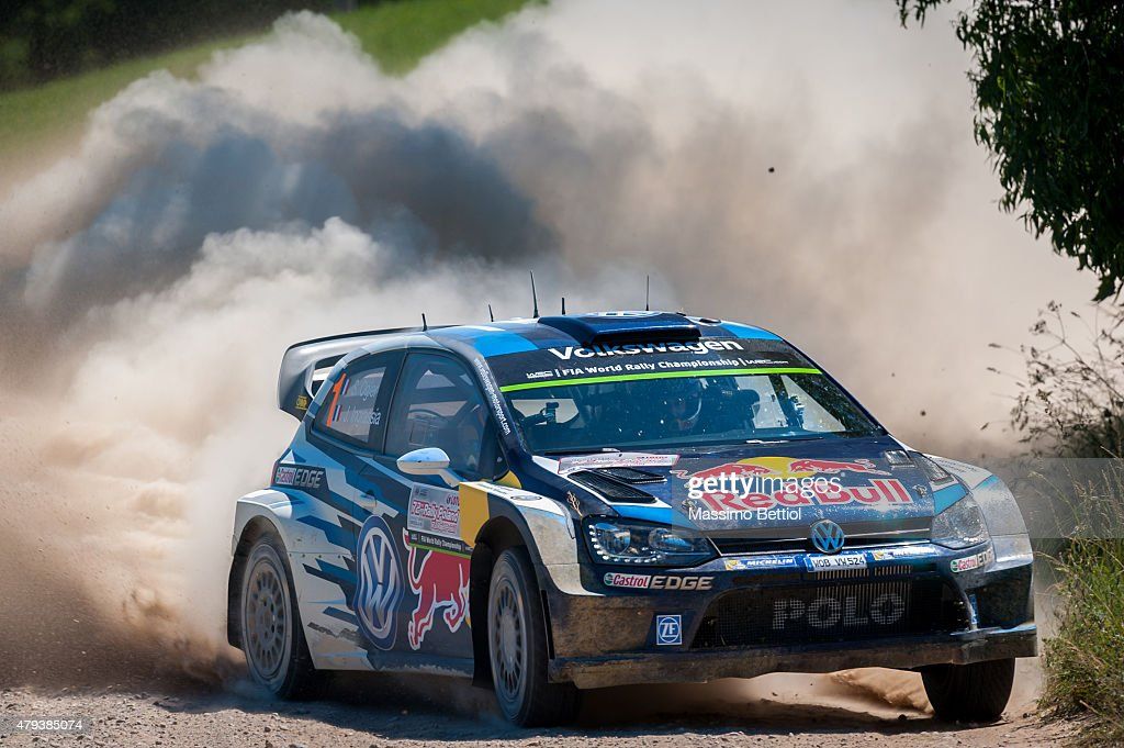 Sebastien Ogier of France and <a gi-track='captionPersonalityLinkClicked' href=/galleries/search?phrase=Julien+Ingrassia&family=editorial&specificpeople=4947850 ng-click='$event.stopPropagation()'>Julien Ingrassia</a> of France compete in their Volkswagen Motorsport Volkswagen Polo R WRC during Day One of the WRC Poland on July 3, 2015 in Mikolajki, Poland.
