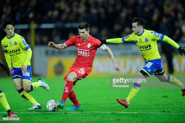 Sebastien Pocognoli defender of Standard Liege is challenged by Tuur Dierckx forward of Beveren and Ryota Morioka forward of Beveren during the...