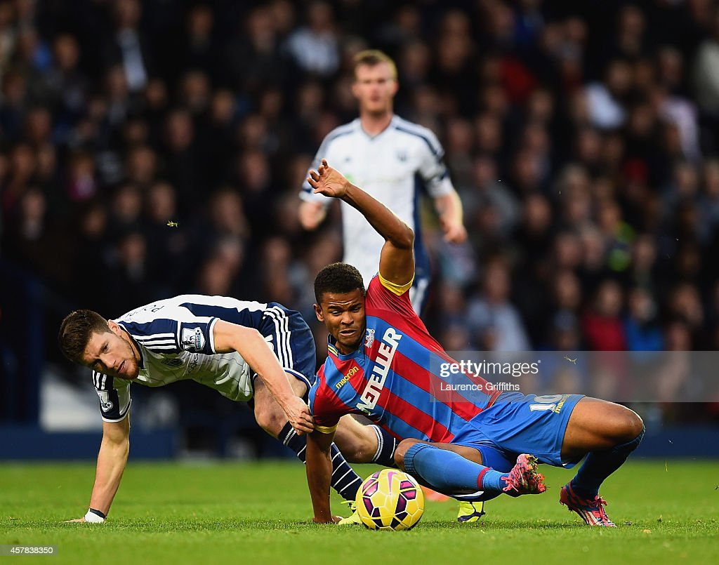 Sebastien Pocognoli of West Brom and Fraizer Campbell of Crystal Palace battle for the ball during the Barclays Premier League match between West Bromwich Albion and Crystal Palace at The Hawthorns on October 25, 2014 in West Bromwich, England.