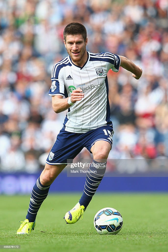 <a gi-track='captionPersonalityLinkClicked' href=/galleries/search?phrase=Sebastien+Pocognoli&family=editorial&specificpeople=3942105 ng-click='$event.stopPropagation()'>Sebastien Pocognoli</a> of West Bromwich Albion tangles during the Barclays Premier League match between West Bromwich Albion and Everton at The Hawthorns on September 13, 2014 in West Bromwich, England.