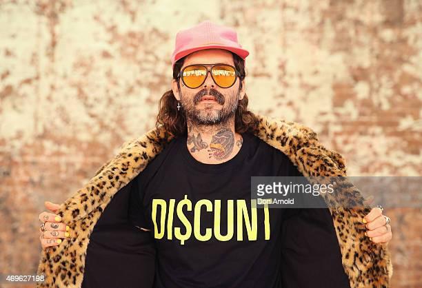 Sebastien Rougere wears Mink Pink jacket Discount Universal Tshirt Levis Jeans Happy socks and Converse shoes at MercedesBenz Fashion Week Australia...