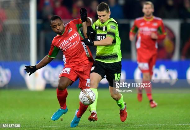 Sebastien Siani midfielder of KV Oostende battles for the ball with Marin Razvan midfielder of Standard Liege during the Belgian Croky Cup match...