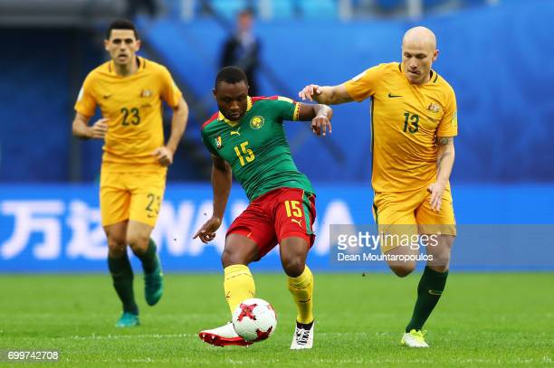 Sebastien Siani of Cameroon and Aaron Mooy of Australia battle for possession during the FIFA Confederations Cup Russia 2017 Group B match between...