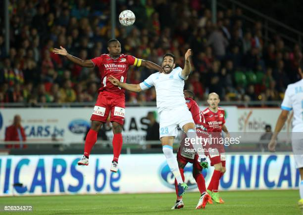Sebastien Siani of KV Oostende and Adil Rami of OM during the UEFA Europa League third qualifying round second leg match between KV Oostende and...