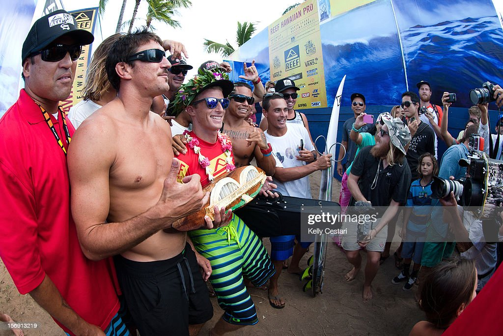 Sebastien Ziets of Kauai, Hawaii celebrates victory with friends and fans after winning the 2012 REEF Hawaiian Pro at Ali'i Beach Park on November 24, 2012 in Haleiwa, Hawaii.