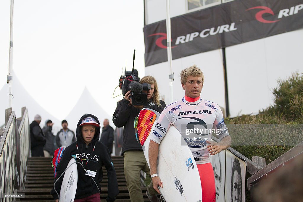 Sebastien Zietz heads down the stairs for his round three heat of the Rip Curl Pro on April 1, 2013 in Bells Beach, Australia.