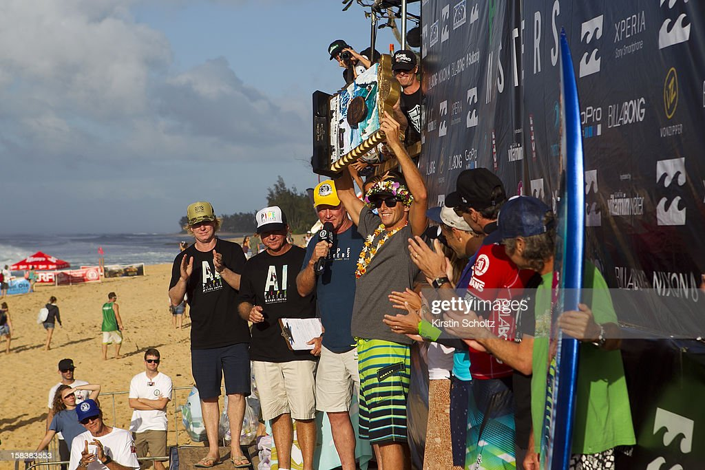 Sebastien Zietz of Hawaii holds up his Triple Crown of Surfing Trophy on December 14, 2012 in North Shore, Hawaii.