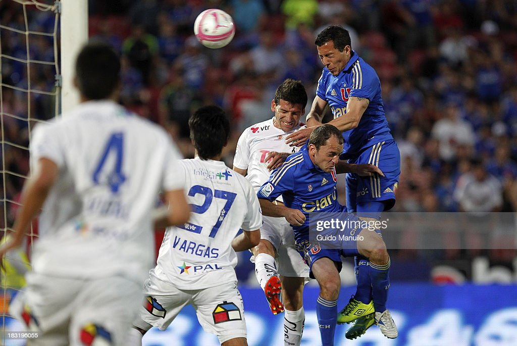 Sebastián Ubilla of Universidad de Chile heads the ball during a match between O'Higgins and U de Chile as part of the Torneo Apertura at National Stadium, on October 05, 2013 in Santiago, Chile.