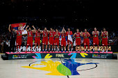 Sebia players pose for a picture during the award ceremony after the 2014 FIBA World Basketball Championship final match between USA and Serbia at...
